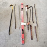 LOT OF CROW BARS AND LEVEL