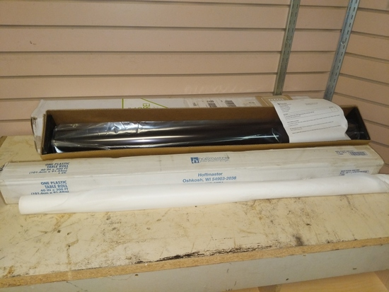 New roll of one way mirror film and partial t tablecloth cover