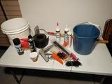 Caulk and caulk guns, zip ties, buckets, wasp spray