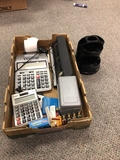 Office supplies, calculator, hole punch and post it