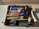 Liquid nail, caulk gun, wood putty, and brushes