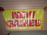 """Assortment of Banners Miscellaneous business banners, two """"new games"""", one """"grand opening"""""""
