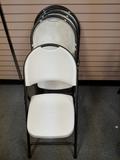 Folding plastic chairs