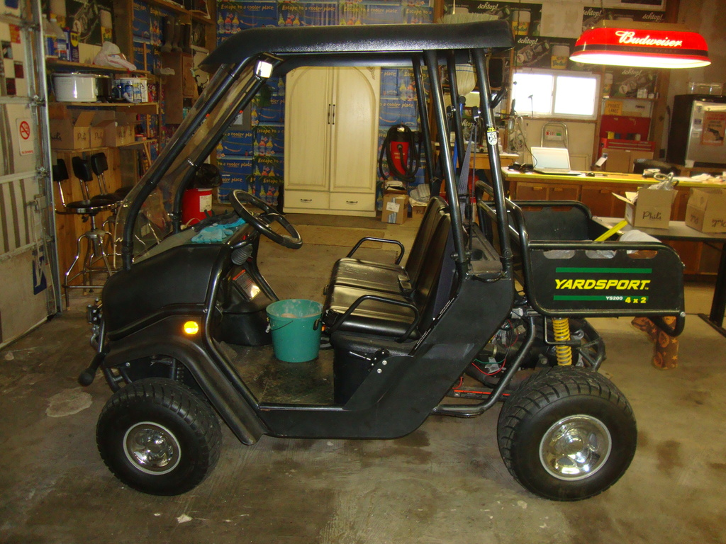 Yardsport XLT ys200 4X2 sport utility vechicle, front mounted wench & plow