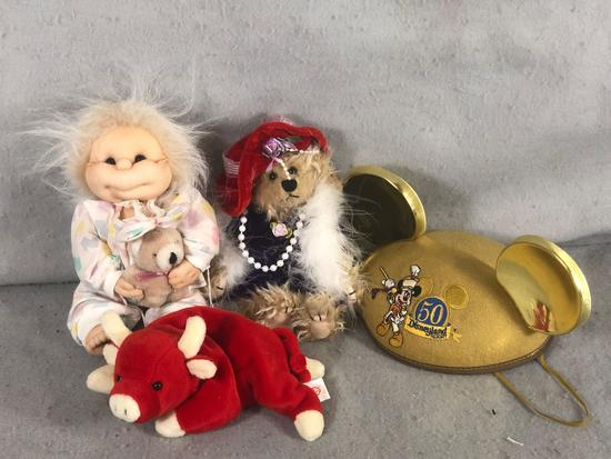 Assorted Stuffed Animals and Mickey Mouse Hat