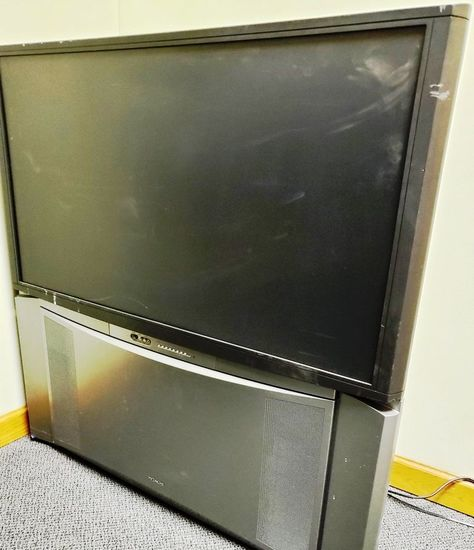 2 rear projection TVs