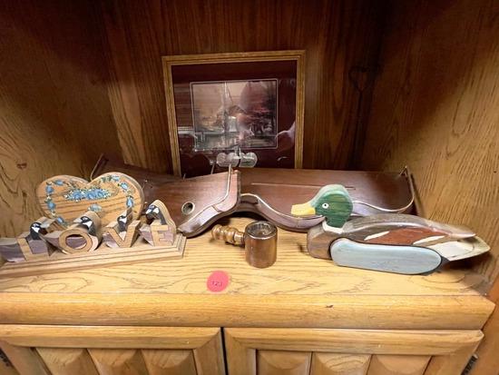 Shelves and decorative grouping with Thomas Kinkade