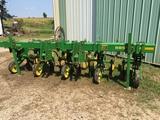 JD 885 4/38 3pt no-til row crop cultivator, gauge wheels, wide sweeps, fenders, , shedded.
