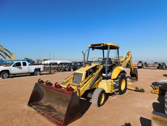 Located in YARD 1 - Midland, TX (1905) NEW HOLLAND LB75B LOADER BACKHOE S/N 0310