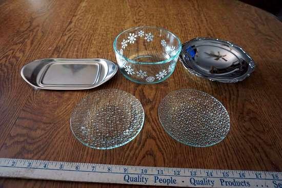 Serving bowls, plates, silver service pieces.