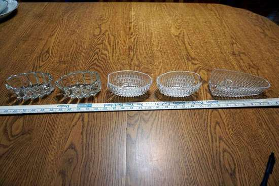 Assorted cut glass silverware rests.