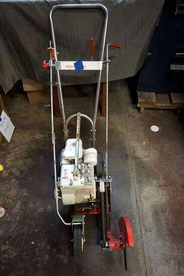lawn edger. Briggs and Stratton motor.