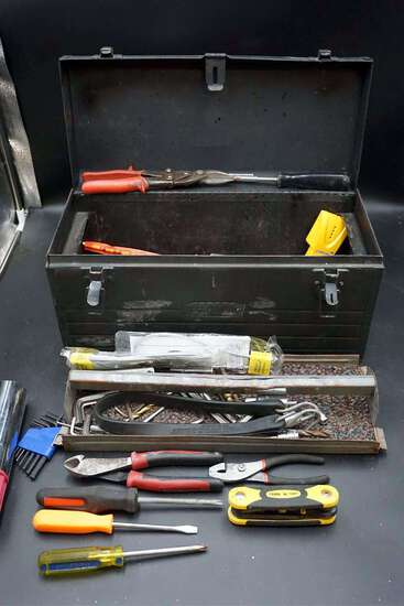 Toolbox full of tools and hardware.