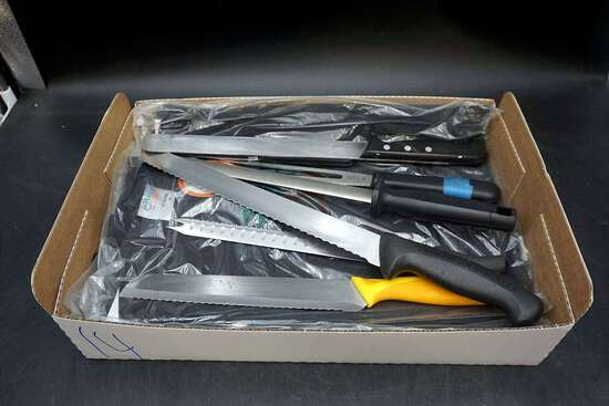 Set of large knives. Chefs clothing.