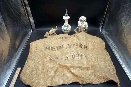 New York burlap sack, elephant, soap dispenser, owl.