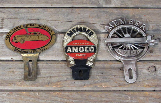 3 Vintage License Plate Toppers Amoco, State Farm, NMRA