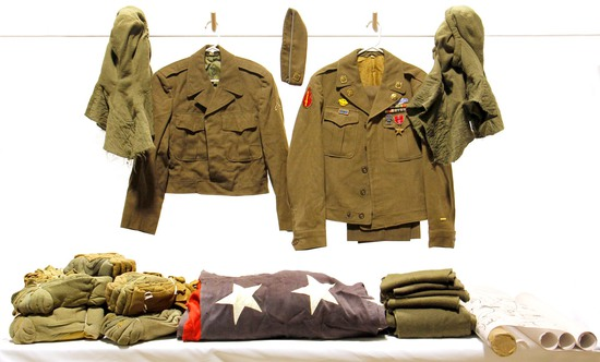 Lot of WWII U.S. Army Uniforms with Bundles of Military Socks and National United States Flag