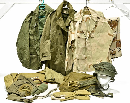 Lot of Field Jackets, Blouses, Helmet with Camouflage Netting, Gloves, Clothing Bag