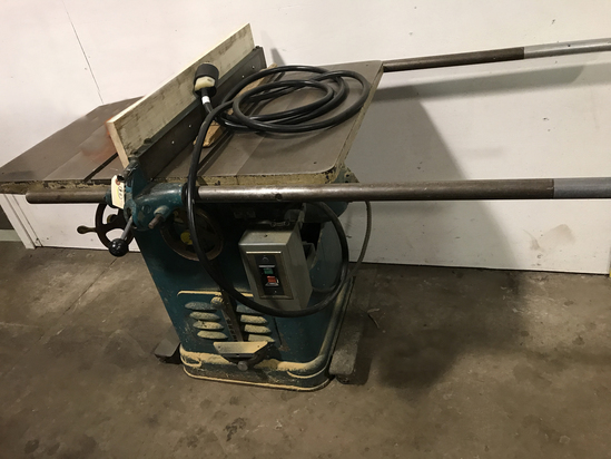 "Delta 10"" Unisaw table saw with long extension table"