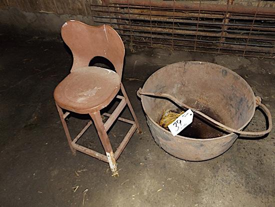 Old metal kettle, metal stool