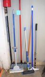Group of brooms, mop, etc.