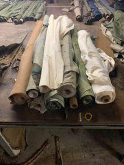9 rolls of cotton fabric ( camo, brown and tan)