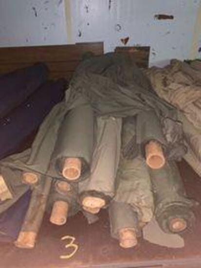 13 rolls of green cotton fabric