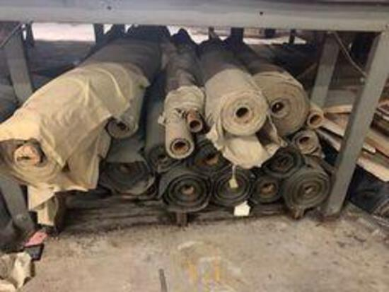 Rolls of green cotton fabric