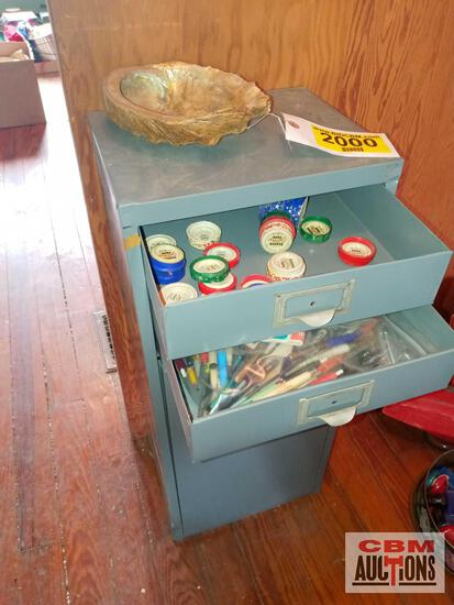 Metal cabinet, assorted pens, decorative tape, staplers and staples, and large shell