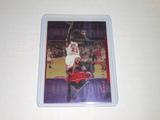 1999-00 UPPER DECK BASKETBALL #45 - MICHAEL JORDAN PURPLE HOLOFOIL ATHLETE OF THE CENTURY