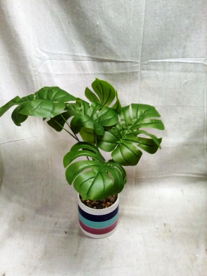 """Aritificial Plant approx. 20"""" tall in planter"""