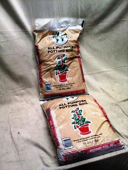 Pair of 16 Qt. bags of Gold Earth Potting Soil