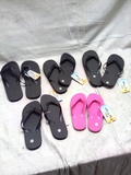 5 Pair of Misc. Sized Flip Flops and Slides
