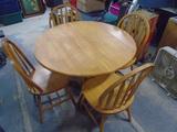 Solid Oak Pedistal Drop Leaf Table w/ 4 Matching Chairs