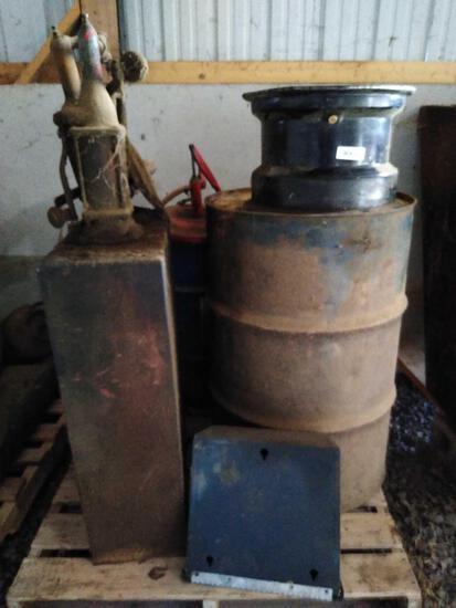 Skid lot of various oil pumps, barrels