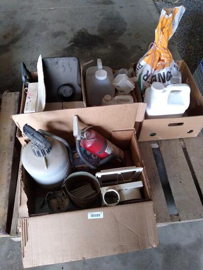 Skid lot of various jugs, pioneer seed corn (P0216AM), mirrors, wiring harnesses, hose fittings