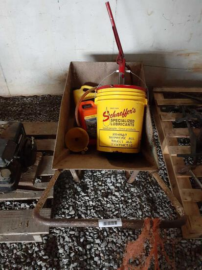Metal yard cart with antifreeze and lubricants inside