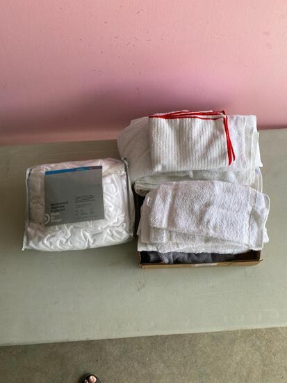 Lot of wash cloths, hand towels and mattress pad