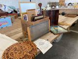 Wooden Aztec calendar, frames, prints, shadow box
