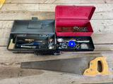 Tape measures, would chisels, saw and little tool boxes