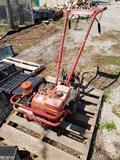 Troy-built gas roto-tiller.