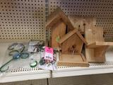 Assorted squirrel feeders and accessories. New.