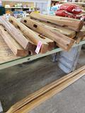 Assorted split fence posts and two rails on floor. New.