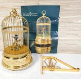 Vintage Swiss Reuge Automaton Bird in Gold Gilt Cage with Hanger & Paperwork