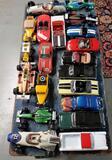 17 Die Cast Cars, 1 Plastic Race Car & 2 Race Car Liquor Decanters Out Of Boxes