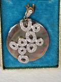 Polished Shell Set in 10k Gold with Diamond Accents Pendant