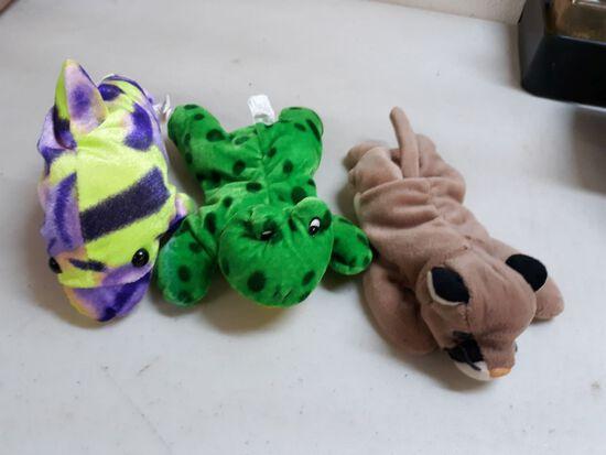 three small plush animals