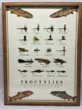 Framed shadow box of salmon flies together with print of trout flies