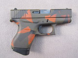 handgun: GLOCK MODEL 43 CAMO, 9X19 SEMI AUTO PISTOL, S#AFCV590