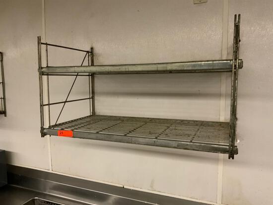 Two wall mounted racks
